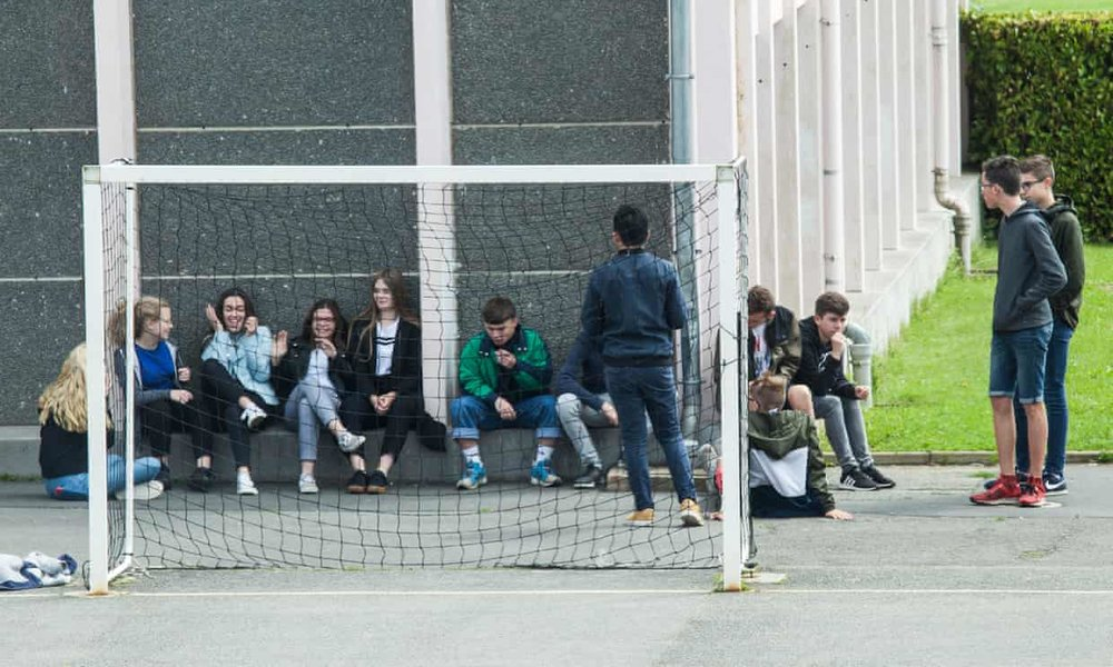 Students talking to each other at a school in Brittany, France. Image via The Guardian.