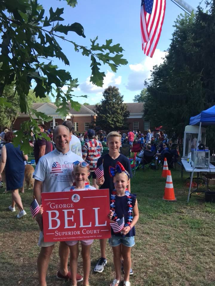 George Bell on the campaign trial with his three children, ages 12, 9, and 7 at the Davidson Parade on July 4, 2018.