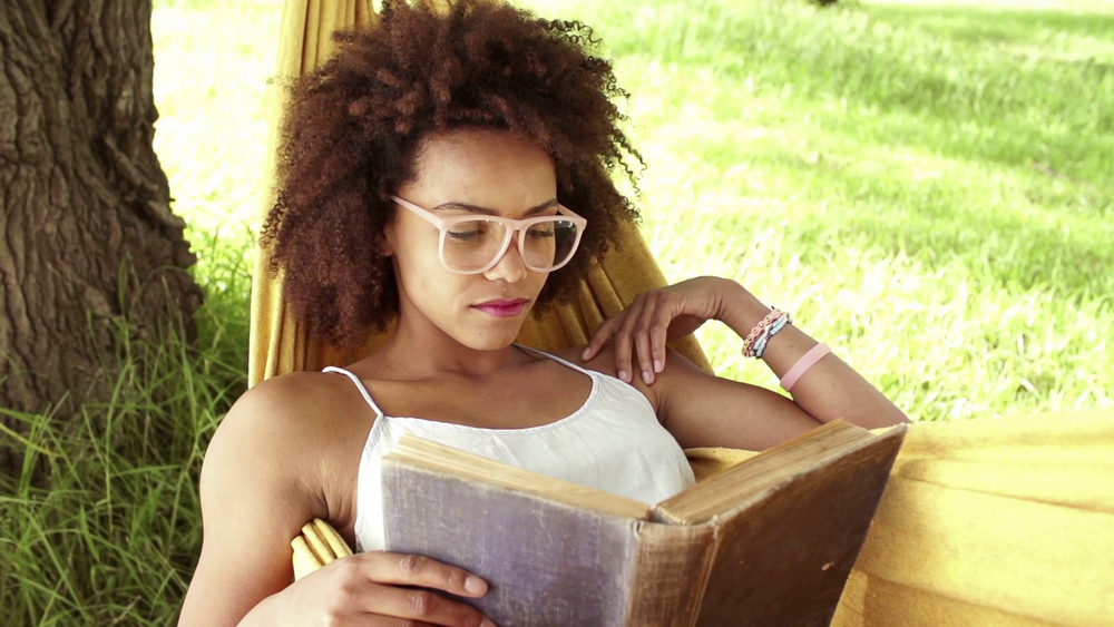 young-african-american-woman-reading-book-in-a-hammock_stlfezq4x_thumbnail-full01.png