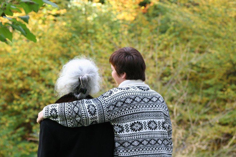 banner_arm_around_elderly_woman.jpg