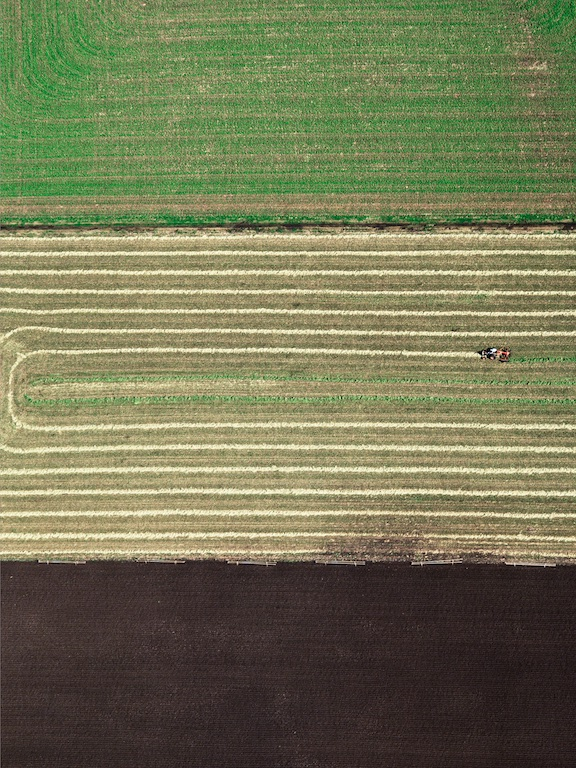 Harvesting hay, Toowoomba, Queensland, Australia.  The black soil plains contrast against the crops.