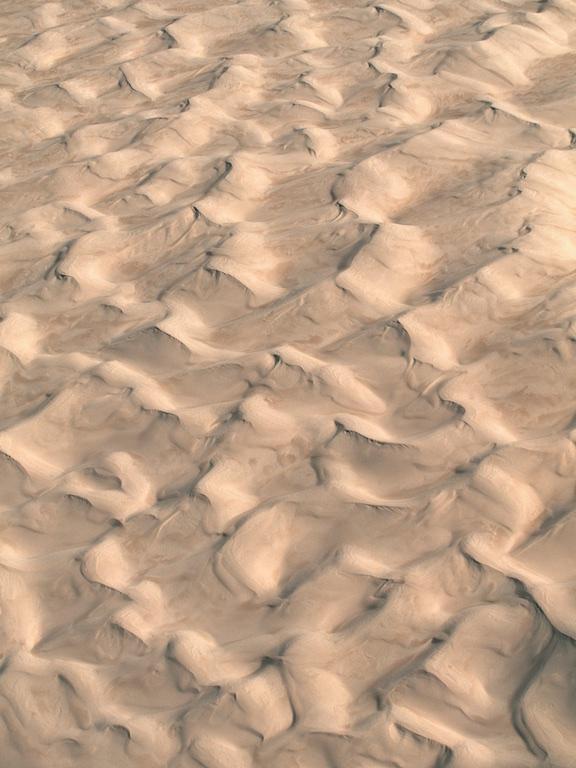 Sand dunes north of Lancelin, Western Australia, Australia.  Coastal wind creates a wave like pattern on the sand.