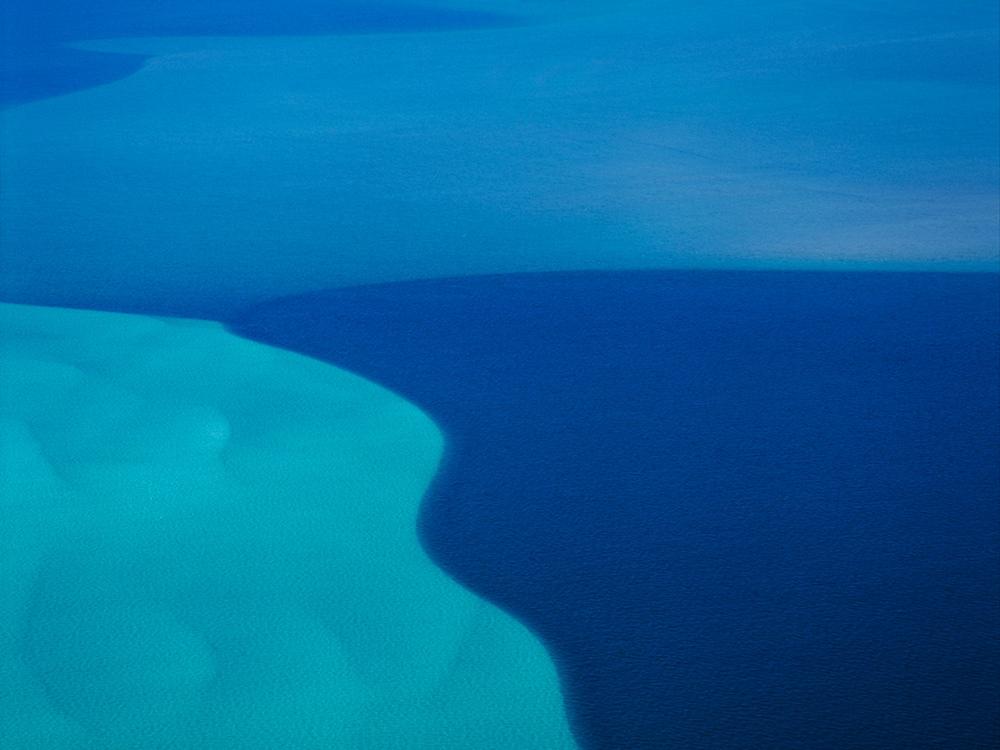 Ocean between Ningaloo Reef and Coral Bay, Western Australia, Australia.  The blue variation is due to the ocean's floor level.