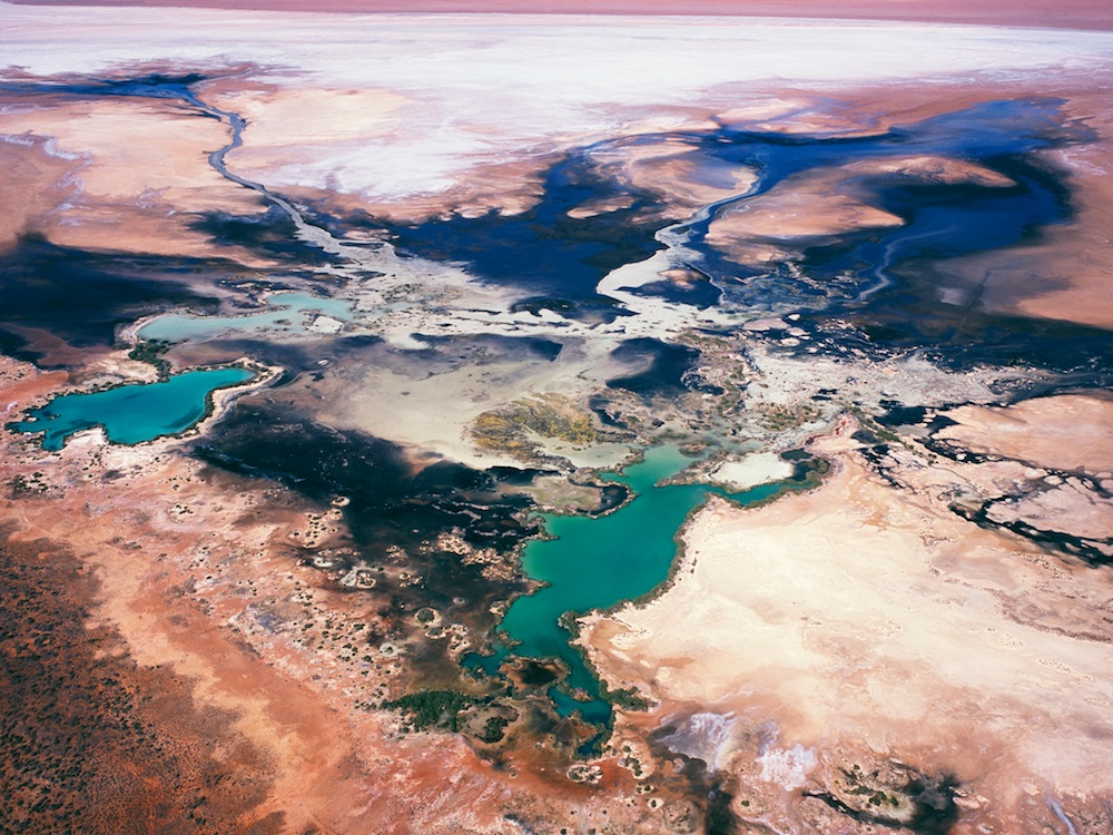 Water patterns, Lake Macleod, north of Carnarvon, Western Australia, Australia.  Salt water leaches into the lake from the ocean nearby creating an interesting biological process.