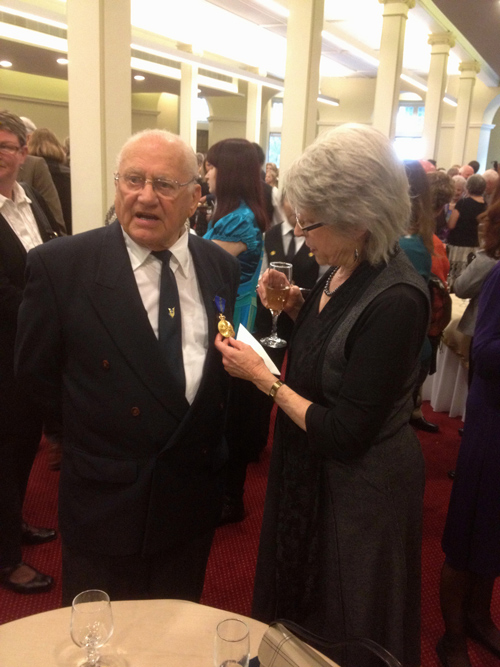 Woldendorp with his Order of Australia medal, being admired by his wife Lyn.