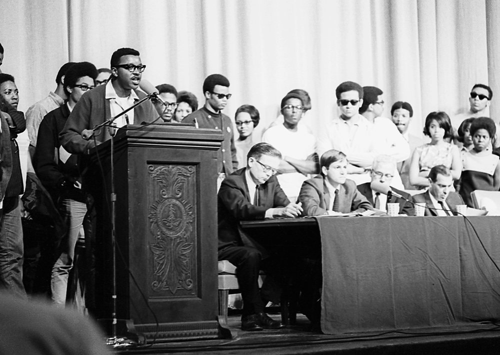 "Members of Stanford's Black Student Union (BSU) ""took the mic"" from provost Richard Lyman at a university wide convocation entitled ""Colloquium and Plan for Action: Stanford's Response to White Racism."" Courtesy of Stanford Libraries."