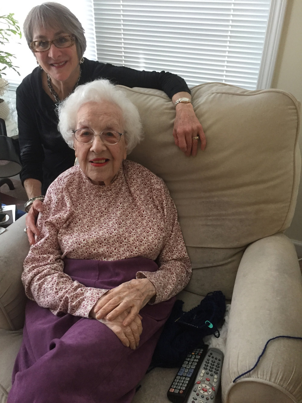 """Me and Bea Samuelson. Bea is 100 years-old and knits a hat a day for refugees and immigrants. """"It beats sitting around all day,"""" she says."""
