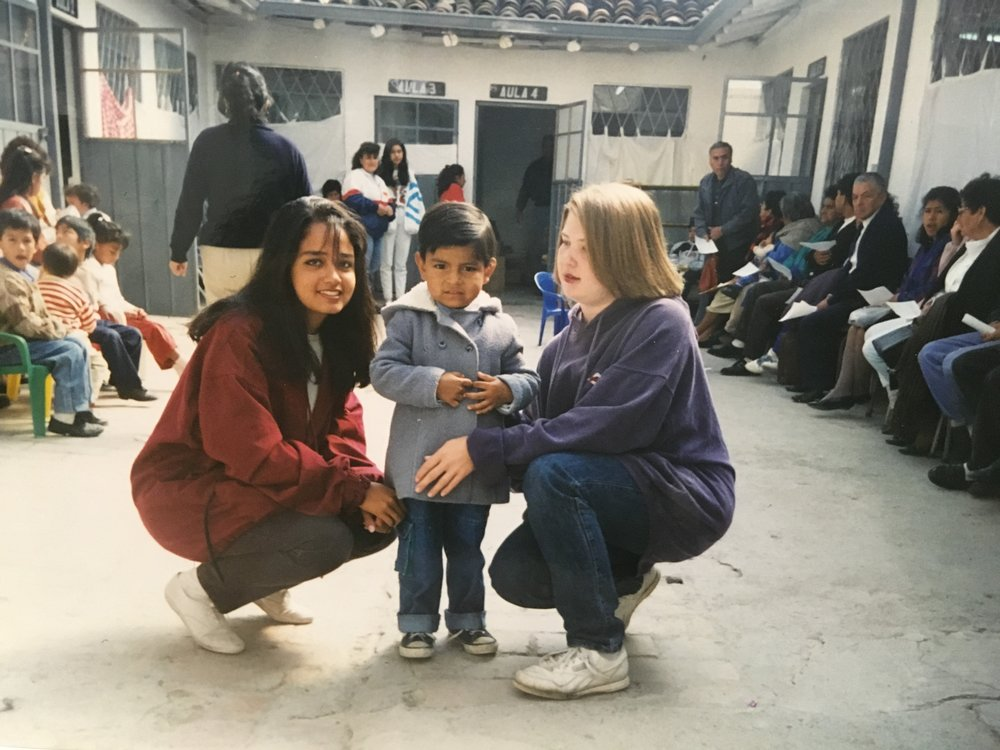 A friend and I playing with Carlos in Ecuador amidst the lines of people waiting for free medical care