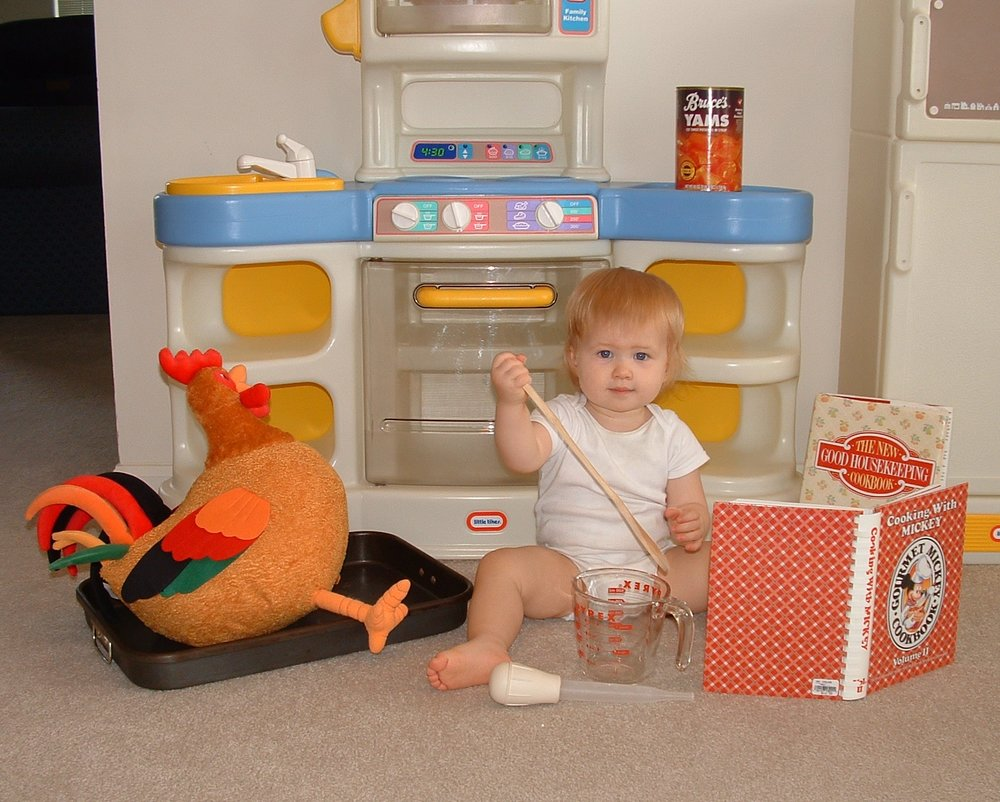 My sous-chef in training! She's come a long way since this photo; now I let her use the real oven.