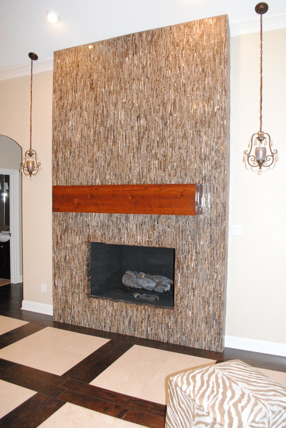 Floor to ceiling glass tile fireplace