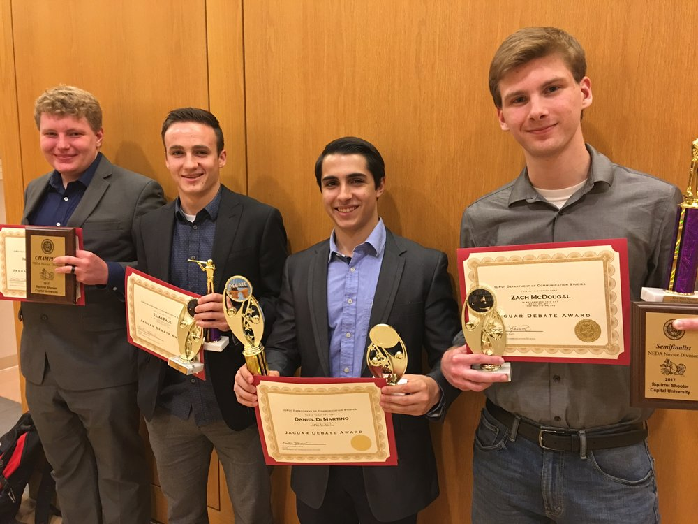IUPUI Debate team with competition trophies, Fall 2017