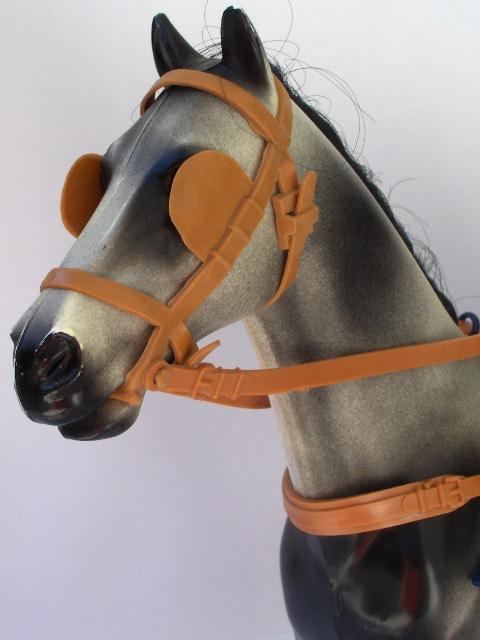 Dapple-Grey-head-in-gig-harness.jpg