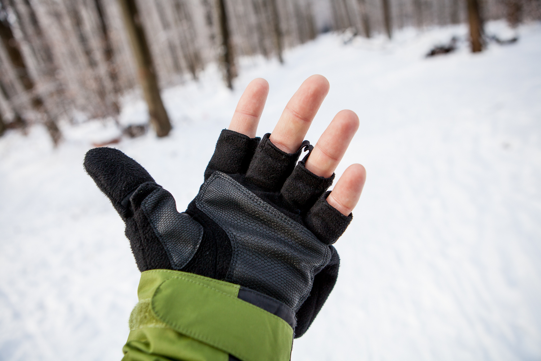 Geöffnete und fotobereite Handschuhe