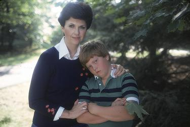 Pictured above: Kathleen Woodiwiss and her son. She clearly deserved a    'brusc-y   .