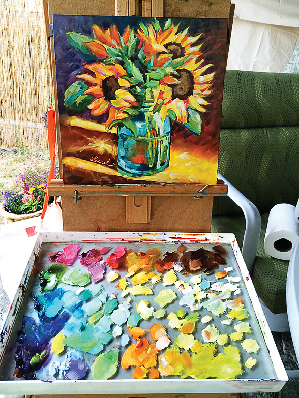 Painting on the patio on a sunny day.