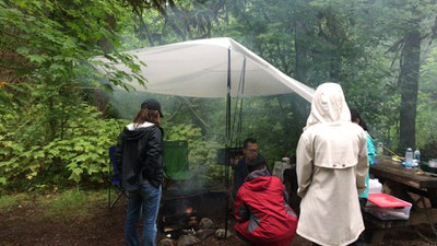 Creative solution – makeshift shelter to cover the campfire!