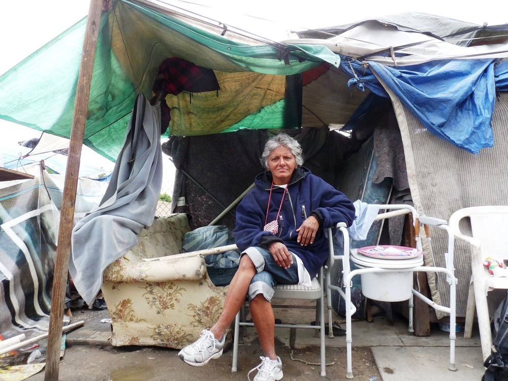 Fresno, CA. 2013. A woman and her makeshift home on Santa Fe Street. Photo taken during my three month residency at the Village of Hope.
