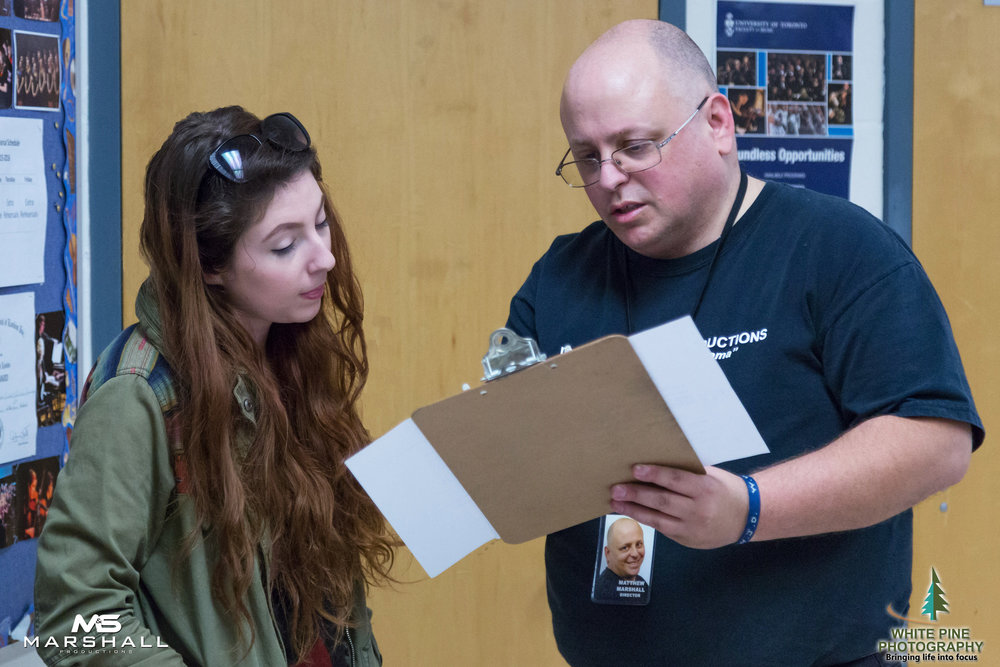 """Film director Matthew Marshall mentoring """"extra"""" actor-  Helena Rose  on a set in an earlier film."""