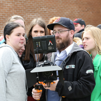 Youth with iFilmGroup.org on movie set