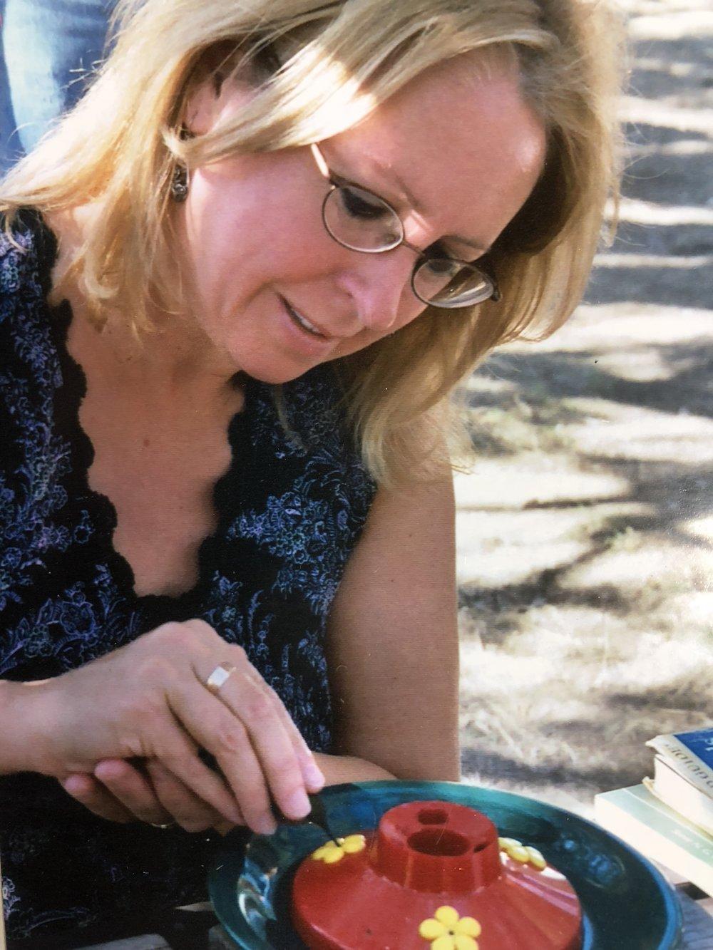 Melissa Morris participating in a hummingbird banding project in Portal, Arizona
