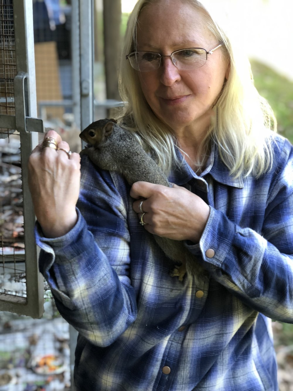 Melissa Morris and a habituated squirrel just learning to become wild again.