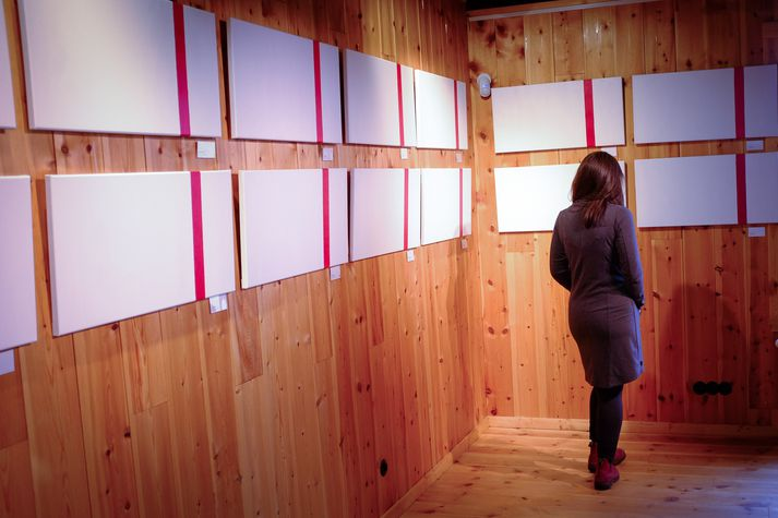 "Artist Fríða Dís Gudmundsdóttir displays her work, ""Próf/Tests"" (translation: Exhibition/Tests) in Ljósanótt, Iceland. This exhibit depicts Fríða's journey through infertility. It took her and her husband 56 months and 56 negative pregnancy tests (i.e., one pink line) before becoming pregnant.  http://www.visir.is/g/2017170909511"