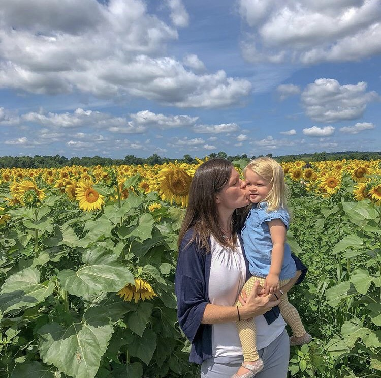 Mary Kate and daughter sunflowers.jpg