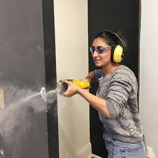 Nassim @nasa.s shows us her badass warrior skills while taking down some walls for our upcoming renovation!👌🏼😎 #starting2019instyle #happynewyear #powertoolsarefun #safetyfirst #makeshift #studio #renovationproject #igerstoronto #collective #makerspace #wemakeshift
