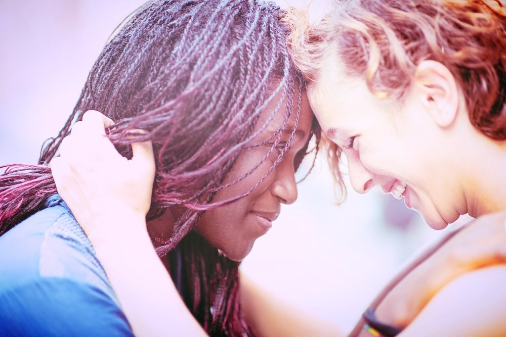 Mixed-race-girlfriends-enjoying-to-stay-together-479703044_1258x838.jpeg