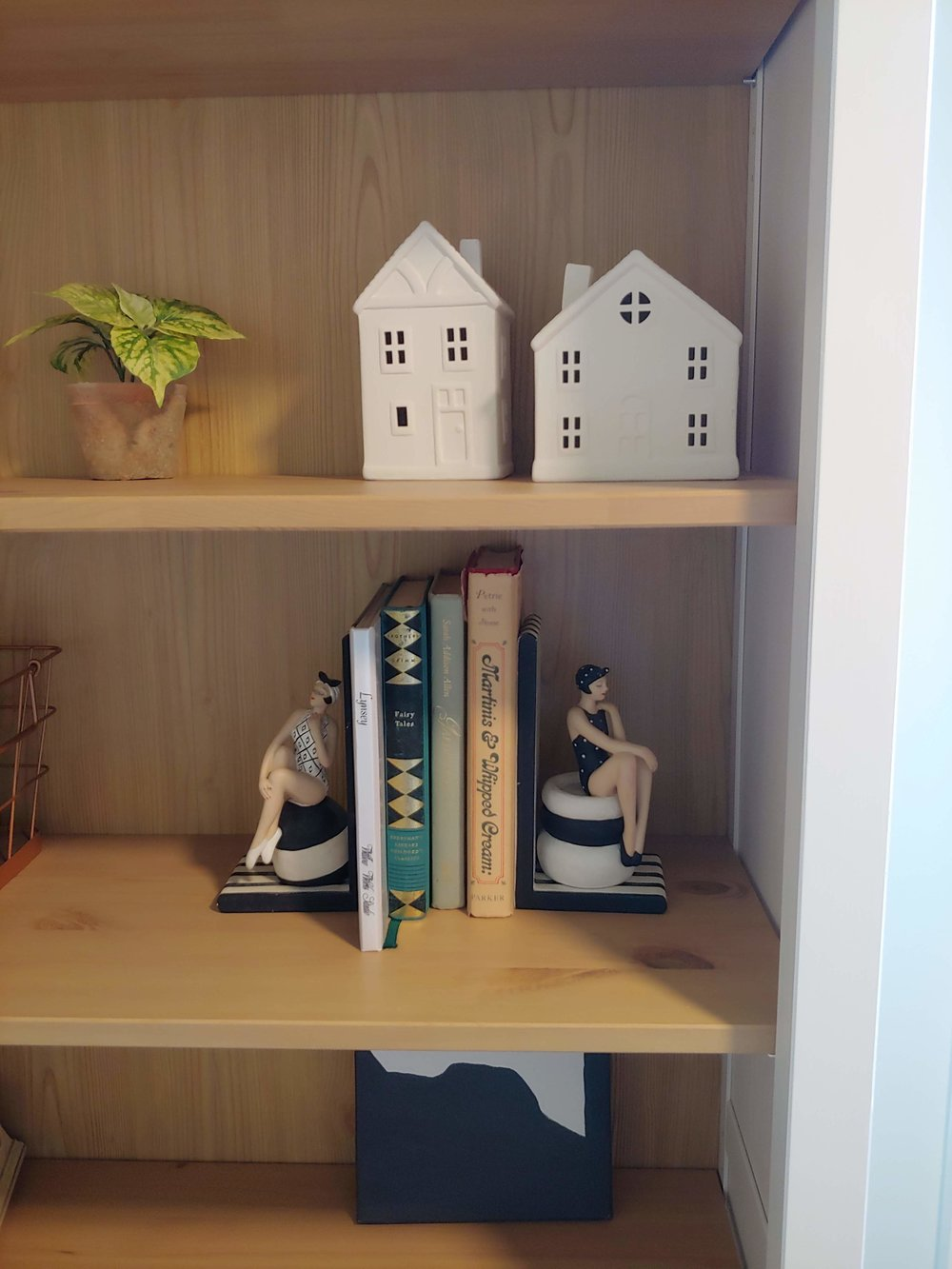 These vintage book ends are a perfect way to highlight some of my vintage books. My mom bought these for me at a yard sale a few years ago.