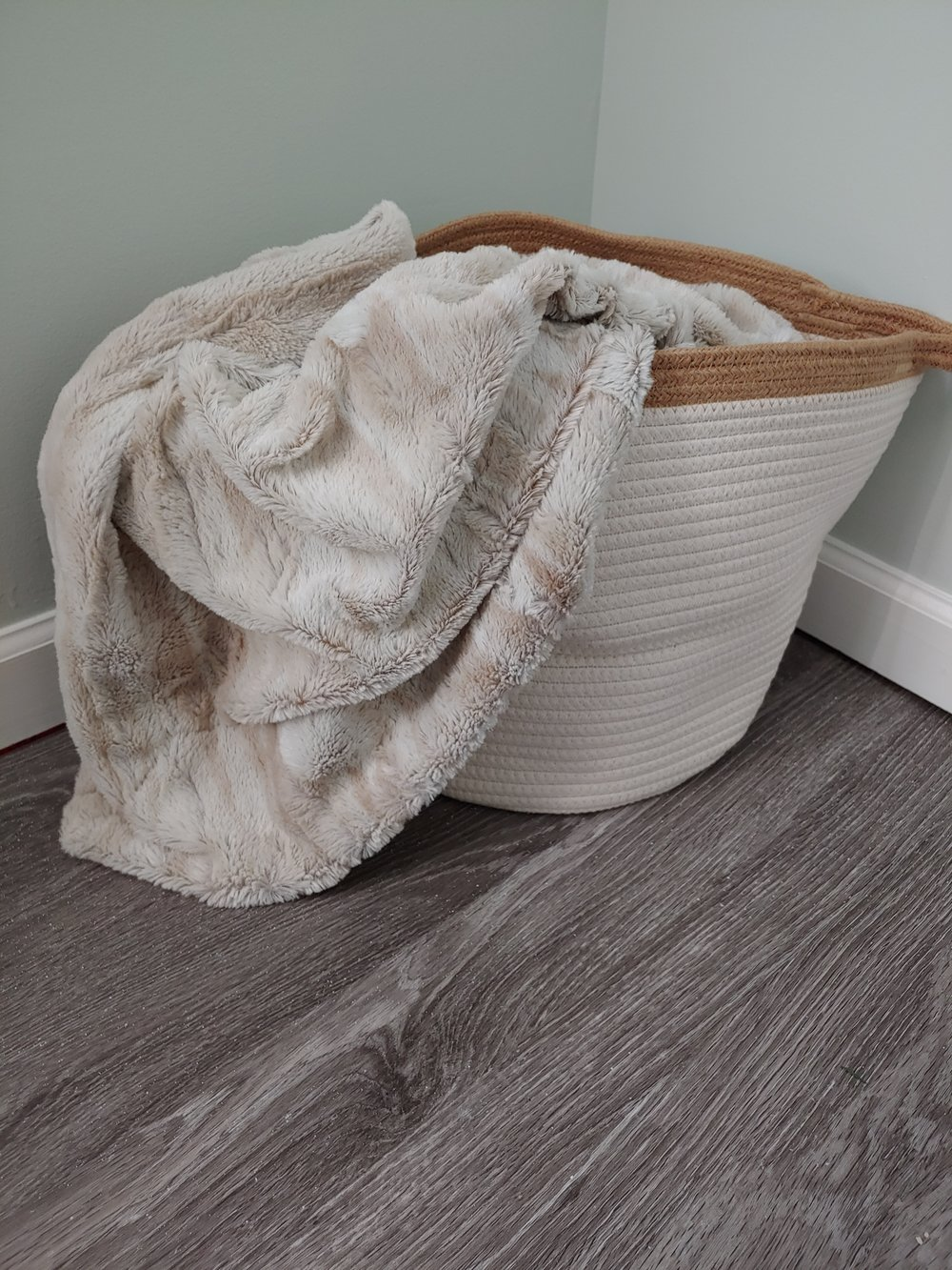 This weaved basket is from amazon. Admittedly I bought this with out paying attention to he size😂. Instead of putting blankets in it I think I may look for a potted plant to put in it.