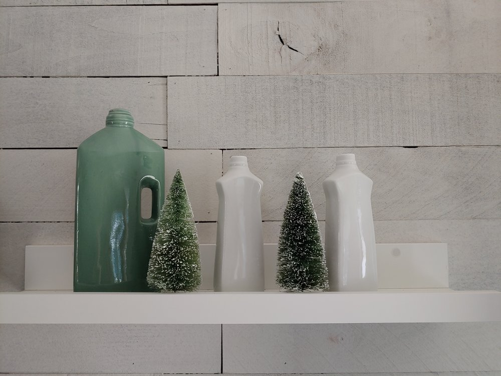 My last decor find is this grouping of bottles. I love the pops of green and the different shapes and sizes, they add nice visual interest.
