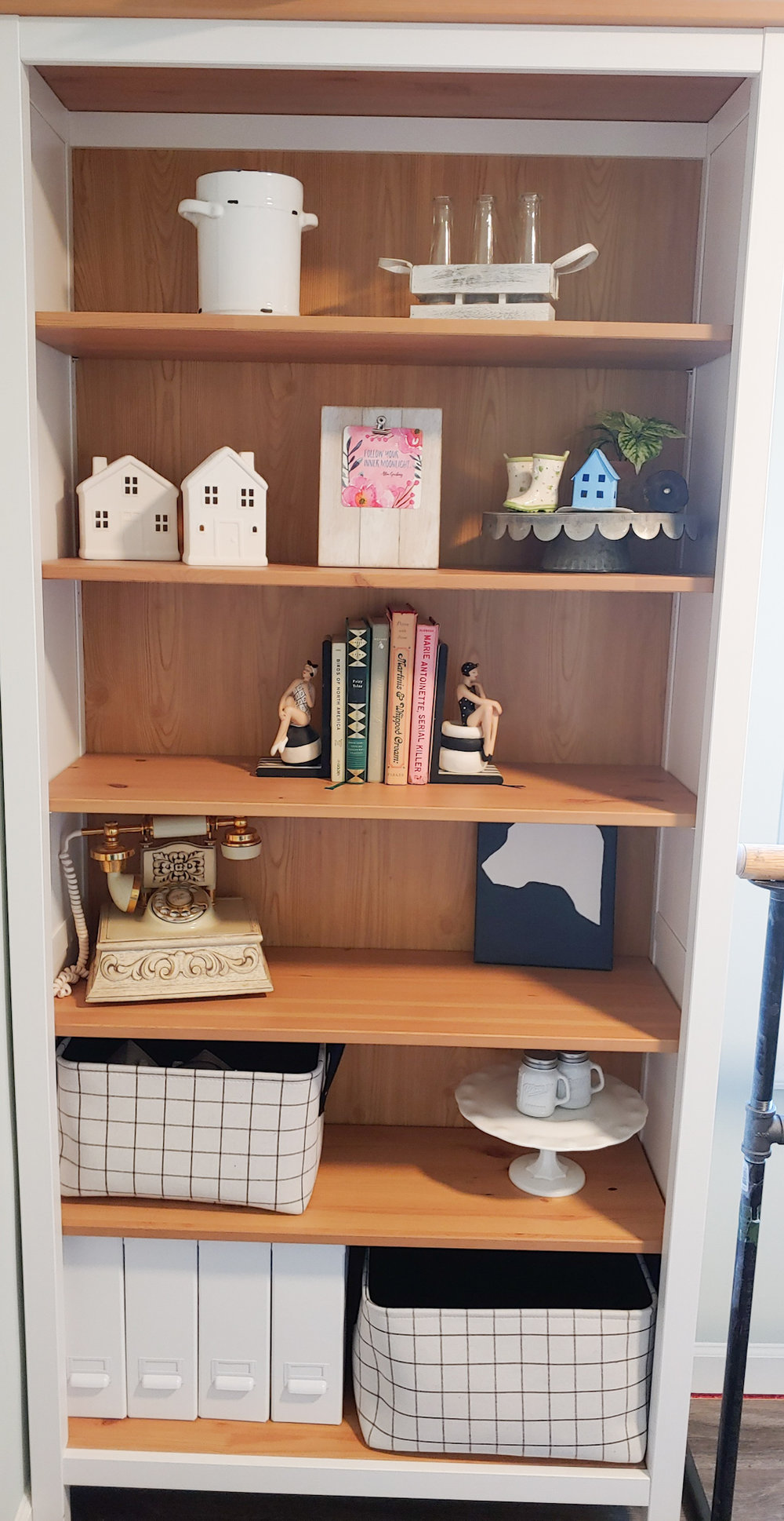 The fabric bins fit perfectly on this bookcase