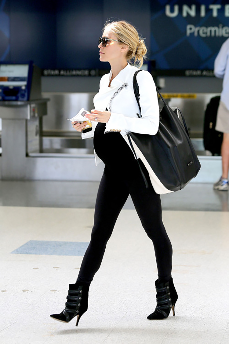 "Los Angeles, CA - Kristin Cavallari bumps her way through LAX this afternoon as she gets ready to catch a flight. The former reality star looked great, showing off her pregnant belly wearing a fitted black top with black leggings and a white leather jacket. Kristin, who is now a host for E!'s show, ""Fabulist"", shared about her second pregnancy, saying that she has ""...more aches and pains. With the first one you can sleep all day, but now I'm running after Camden"". AKM-GSI April 9, 2014 To License These Photos, Please Contact : Steve Ginsburg (310) 505-8447 (323) 423-9397 steve@akmgsi.com sales@akmgsi.com or Maria Buda (917) 242-1505 mbuda@akmgsi.com ginsburgspalyinc@gmail.com"