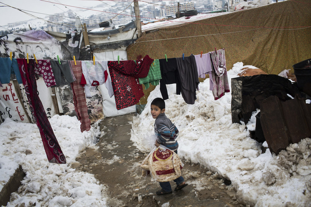 Lebanon. Surviving winter in Fayda tented settlement
