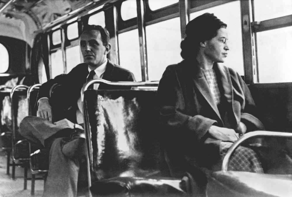 Rosa Parks (born Rosa Louise McCauley on February 4, 1913), who on December 1, 1955 in Montgomery, Alabama sparked a mass bus boycott and became became an international icon of the Civil Rights Movement by refusing to give up her seat to a white man. She continued her activism throughout her life.