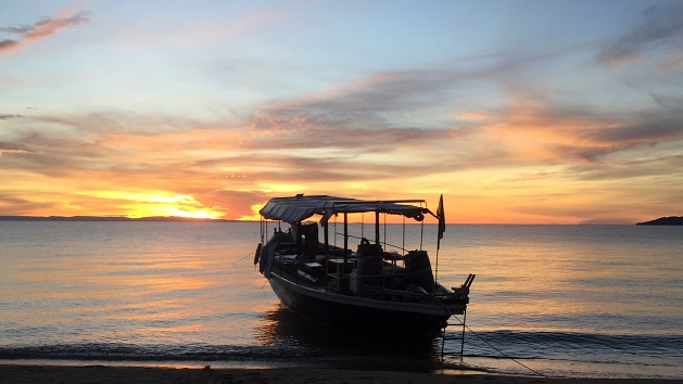 Lake Shore Lodge Tz - Lake Tanganyika - Activities - Sunset Cruise - Wanderer at sunset.jpg