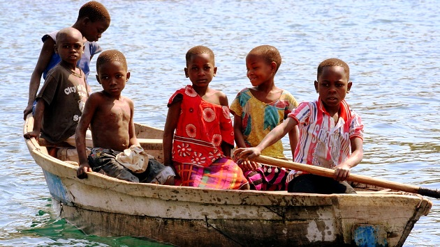 Lake Shore Lodge Tz - Lake Tanganyika - Giving back - Mvuna children in boat.jpg
