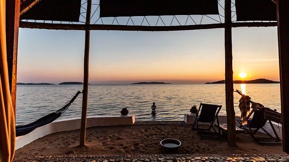 Lake Shore Lodge Tz - Lake Tanganyika - Chalet view at sunset.jpg