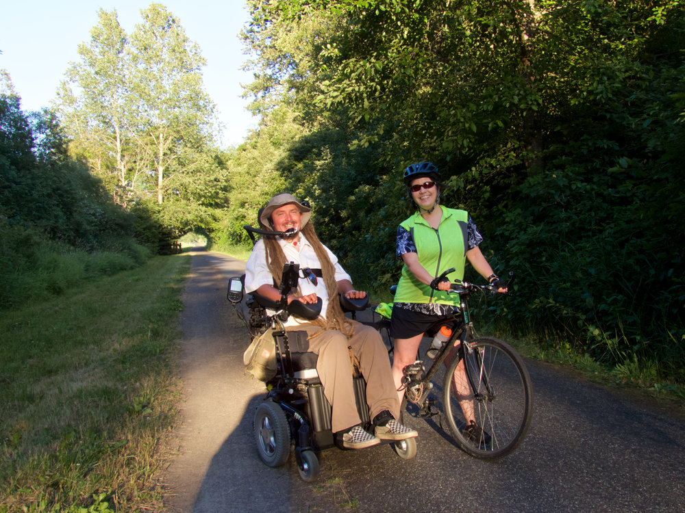 Ian chats with cyclist Nancy Kohn on the Olympic Discovery Trail.