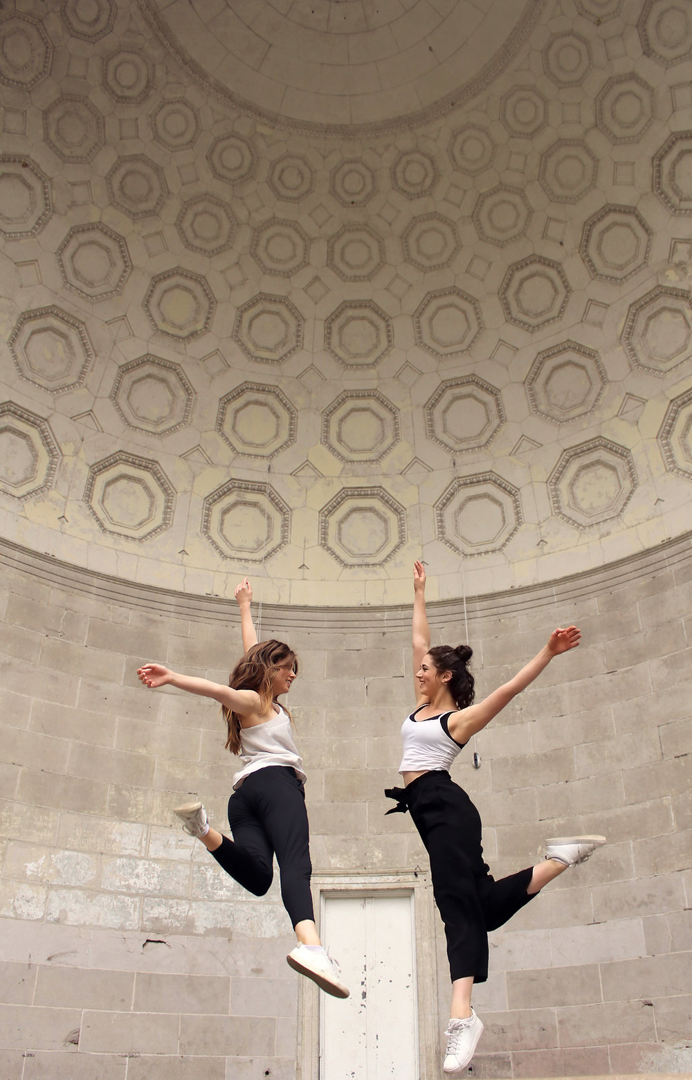 """Symmetryto empathy - With a partnerStand side by side and produce symmetrical movement as if you were mirror images of each other. Keep changing the roles of the leader and the follower. Can you change roles organically without talking?EmpathyThe person leading closes their eyes. Move slowly throughout the exercise. While taking turns in miming each other's movement, try to sense the feeling of your partner while dancing. Write down the feeling you were experiencing when you were the leader"""". Your partner will write down the feeling they sensed off of your movement. Switch roles and repeat the task. After a couple of rounds change your papers to see if you matched.When we mimic each other's movement, we develop kinetic empathy."""