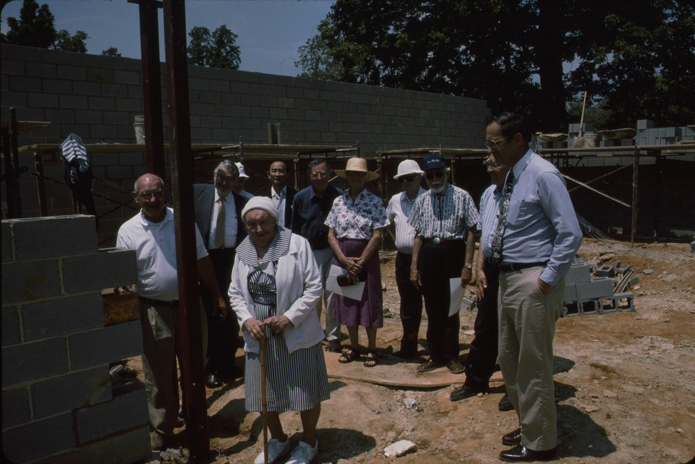 Mary E. Mrose (forefront) at pavilion construction