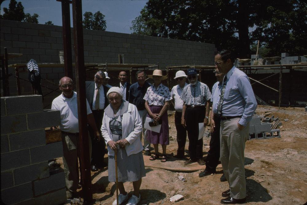 Mary E. Mrose (forefront) at pavilion construction