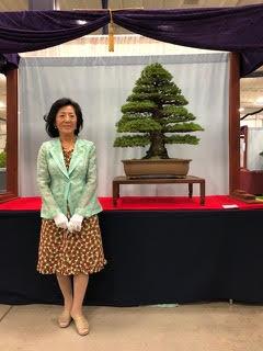 Mrs. Naemi Iwasaki stands with Kokonoe