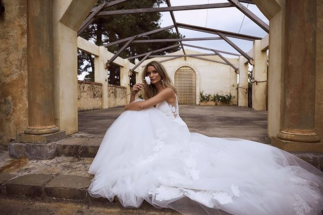 Dancing between modern ingenuity and timeless sophistication, @madilanebridal gowns tell the tale of 'girl meets dress' - a love story within itself. . . . . . #weddinginspo #bridal #confetimagazine #marbella #weddingsspain #mr #mrs #bridal #bridetobe #bridalinspiration #wedding #planyourwedding #weddingsday #destinationwedding #morningbride #weddingstyle #flowers