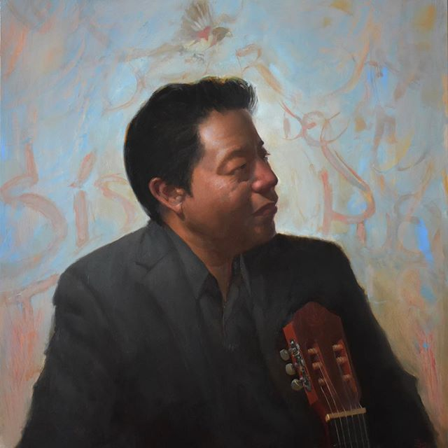 """Finally finished the portrait of my friend, the musician Edgar Santiago @ed1073 . He was very patient in the sessions and I also got to learn a lot about his story. I based some of the writing in the background on the work of the awesome @viejosistem. Oil on aluminum panel, 19x19"""". • • • • • #oilpainting #portrait #portraitpainting #guatemala #art #seattleartist #immigrants #musician #latinmusic #guitar #painting #classicalpainting #atelier #profile #albumcover #oiloncanvas #story #bird #tagging"""