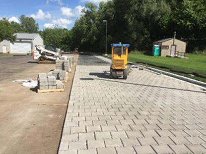 mahtomedi-installing-pavedrain-mats.jpg