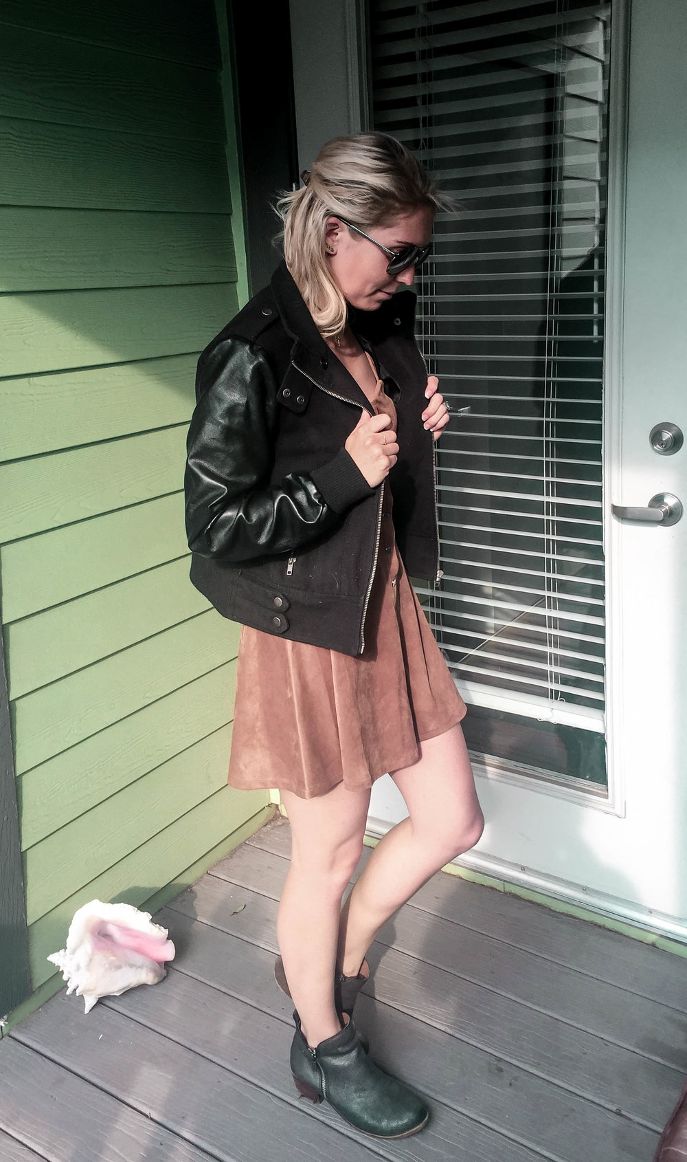 ^ little piece of Florida made an appearance!   Outfit Details:    faux suede dress    (also comes in black) | faux leather jacket (old) (similar    here   ) | black booties (old) (similar    here   ) |    sunnies