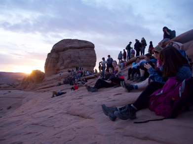 Photographers and tourists overlook Delicate Arch