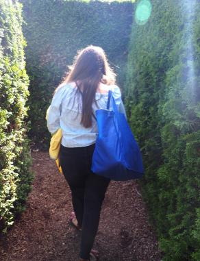 Evelyn entering the hedge maze.